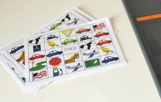 Print up some travel bingo cards with freebie from www.dreamalittlebigger.com