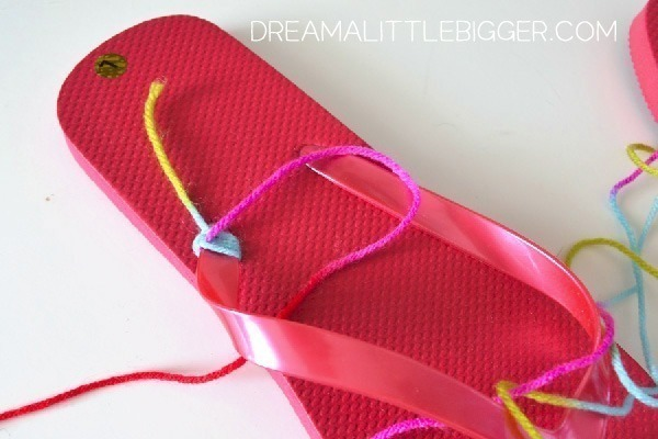 Wrap a pair of flip flop straps with yarn. Really cute.