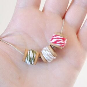 Cute necklace with spools of baker's twine on a chain!
