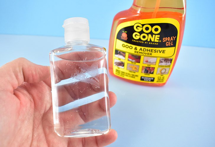 Peel off the labels that came on your hand sanitizers. Clean the goo away with a product like Goo Gone.