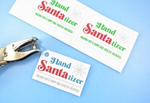 Print the swing tag page of your hand Santa-tizers onto a piece of white cardstock and cut along the faint grey lines. Punch a hole in the corner to hang.