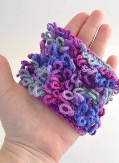 """This loop crochet stitch makes a loopy fabric that is too cute. Strands an be cut for a """"hairy"""" look, too!"""