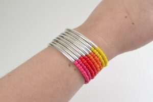 This noodle bead stacking bracelets tutorial is great for anyone, even with NO jewelry making experience. Make a tons of colors for the ultimate outfit!