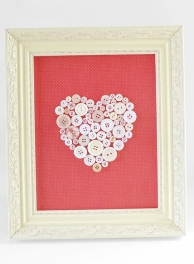 This heart button art tutorial is easy enough for kids but makes some super cute decor adults love, too! Great for home decor on a budget!