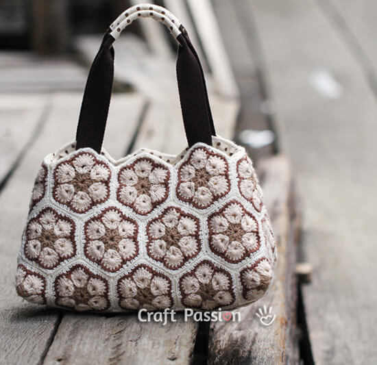 This African Flower Crochet Purse by Craft Passion is so pretty and ...