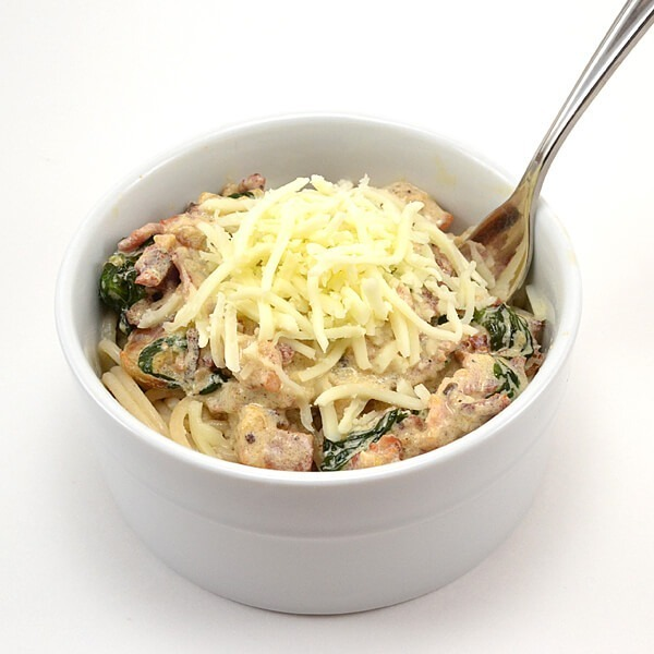 This creamy bacon and spinach pasta works up quickly and is a fast supper in a pinch.