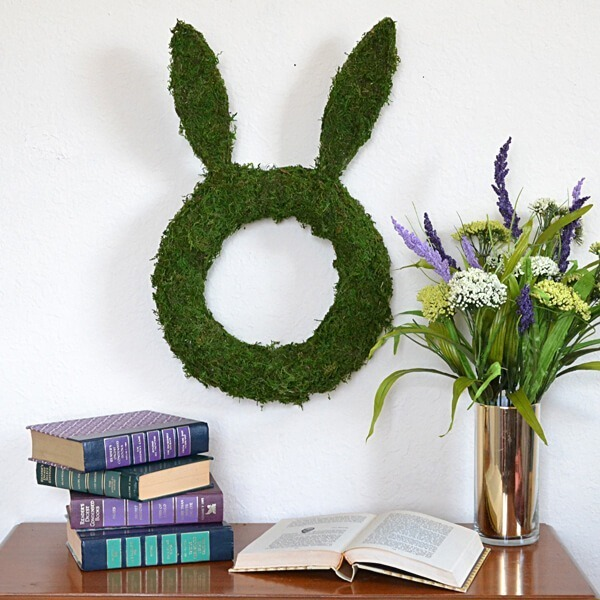 This moss wreath tutorial is easy to follow and makes a modern yet elegant bunny shaped wreath!