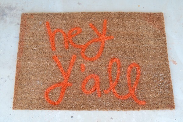 You can make a custom text rug to say absolutely anything. Hey y'all! So neat!