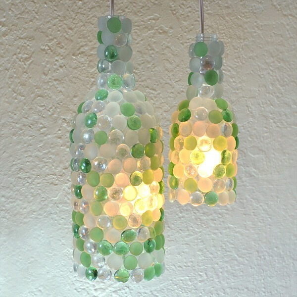 Repurpose those wine bottles by turning them into glass pebble pendant lights!