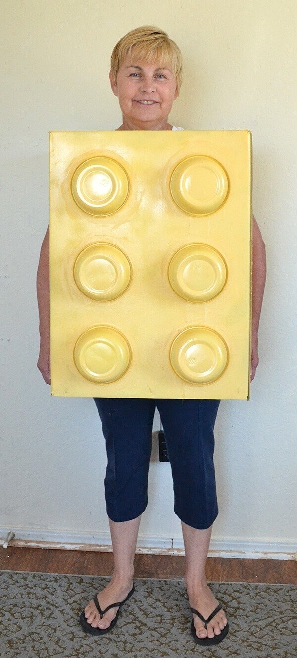 This homemade LEGO costume is so simple and inexpensive to make. Great for kids and adults alike!