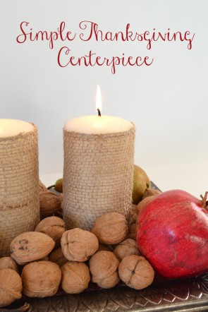 Burlap wrapped candles and fresh fruit and nuts make a simple yet stunning fall centerpiece.