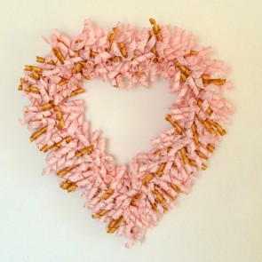 Make this adorable curlicue heart shaped wreath for Valentine's Day!