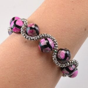 This bead and chain bracelet will glam up any outfit with pretty chain snaking around gorgeous beads.