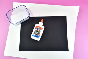 First step is to get the salt onto the paper. Setting up your workspace well will ensure this is a fun and easy craft for the kids.