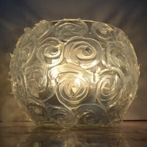 This gorgeously textured swirl candle holder is brilliant when lit! It might surprise you what it's made out of!
