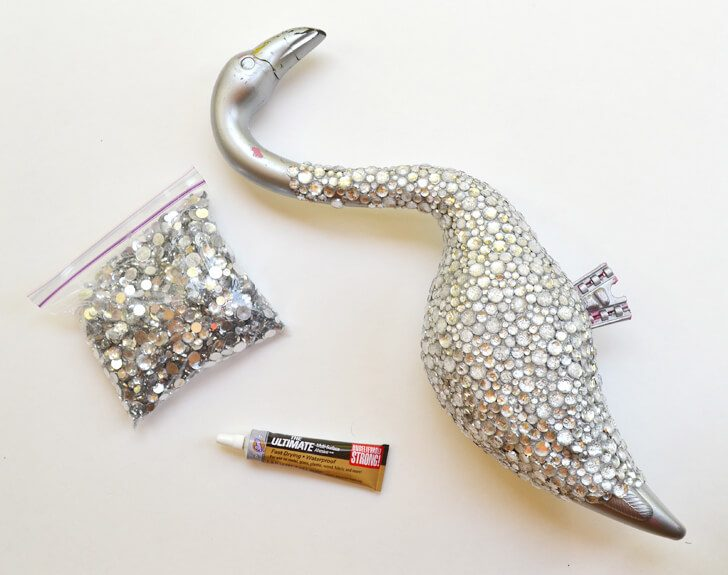 This blinged out flamingo is a totally unique garden accessory you can whip up yourself. You just need the right glue to make it work out!