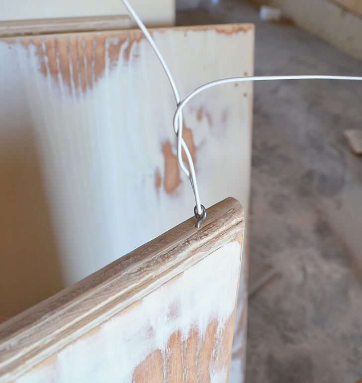 This quick hack makes painting cabinet doors so much quicker. Just grab a metal hanger and let's go! #lifehack