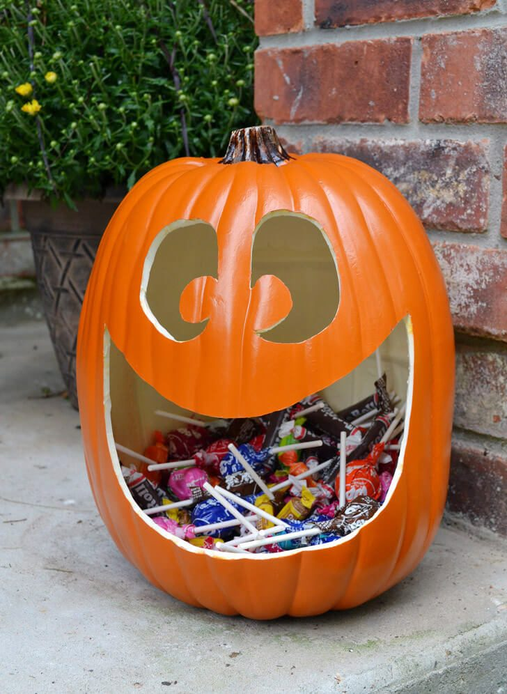 Make the cutest, happiest jack o lantern candy holder. I'm going to have one instead of a plastic bowl when handing out this year!