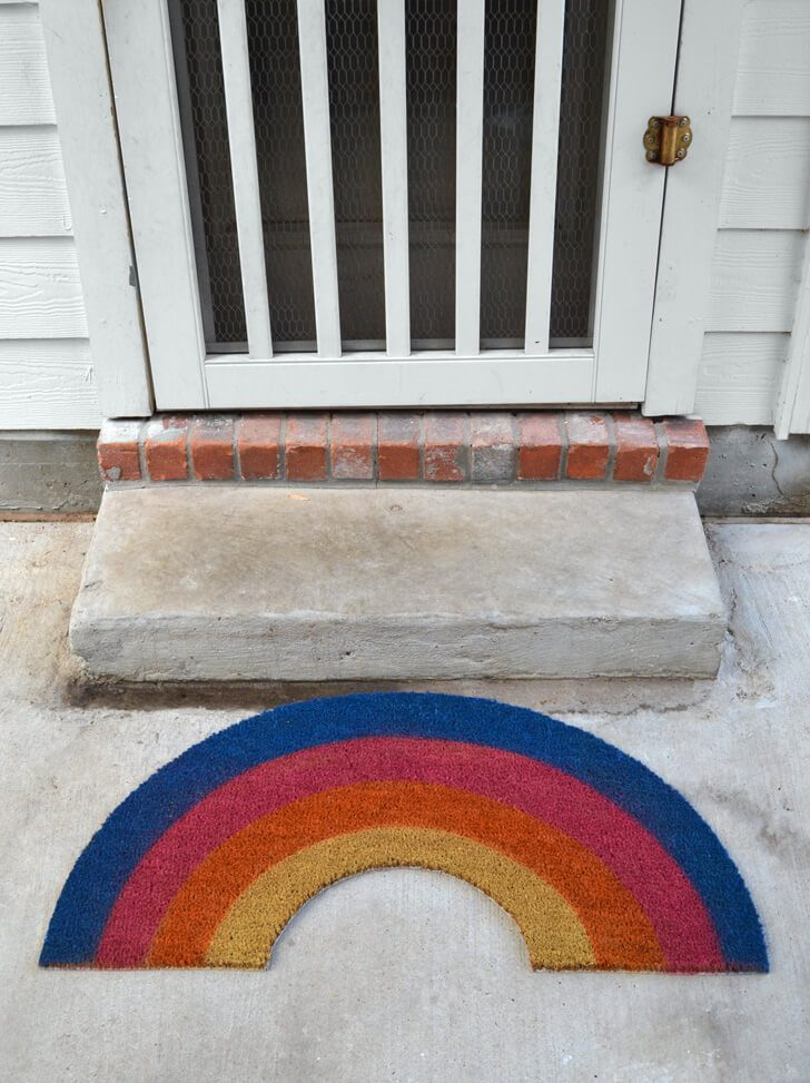 This rainbow rug makes a perfect doormat. It's SO CUTE!