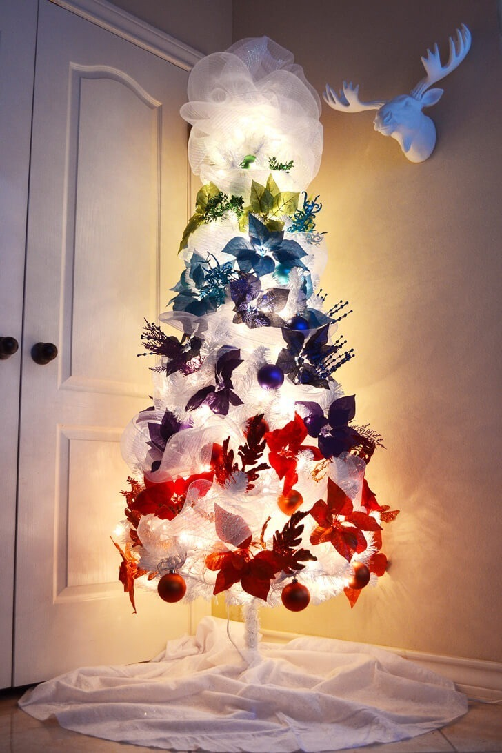 This rainbow ombre Christmas tree is so pretty and so easy to copy! Love  all of the colors on a white tree!