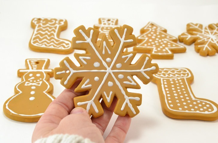 These iced cookie ornaments will make your tree super sweet and last for years. See how to turn ceramic blanks into fantastic cookie ornaments!