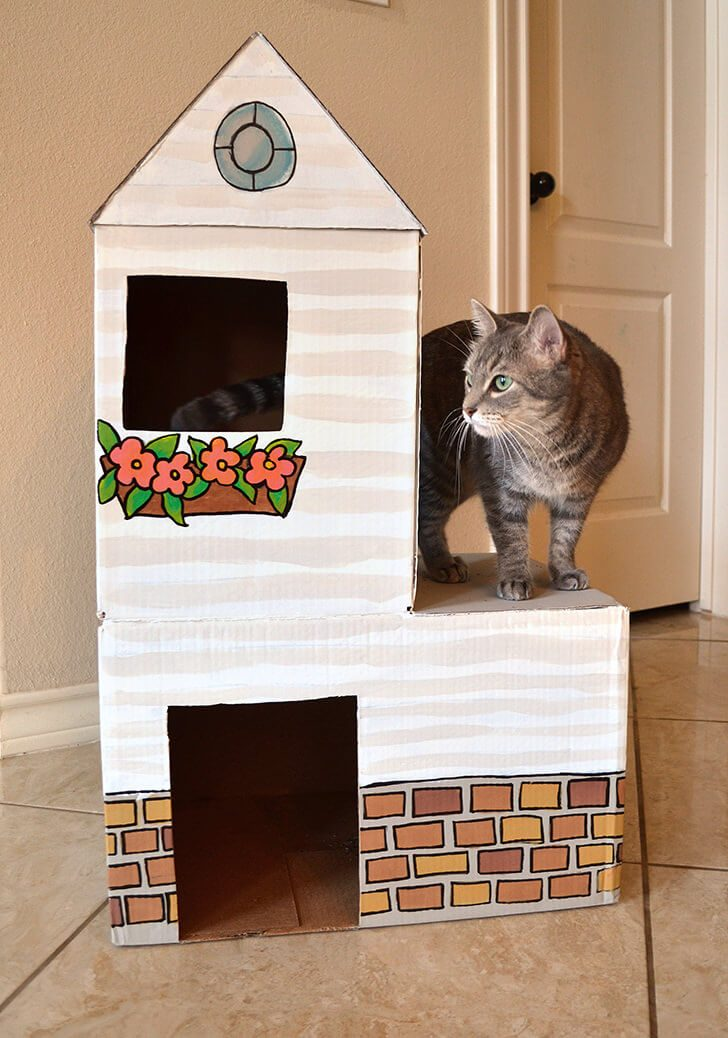 Give kitty something to purr about with their own cardboard cat mansion from upcycled materials!