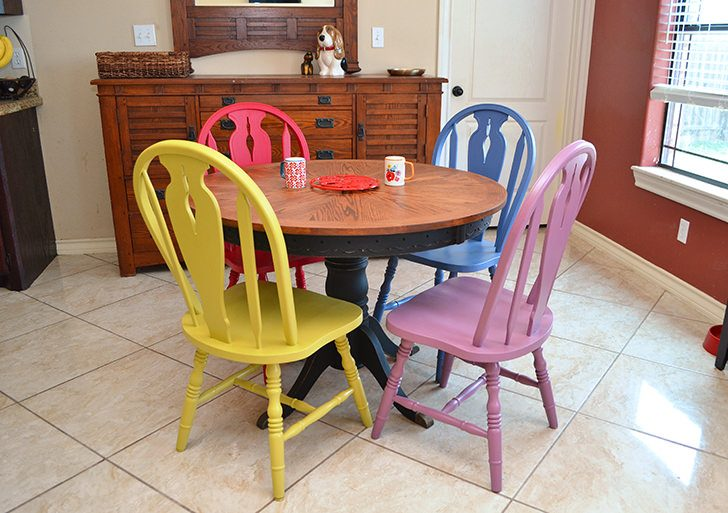 Have a worn out table in need of a bit of a facelift? This colorful kitchen table makeover will add some boho flair and spice up your dinette set!
