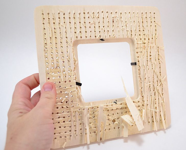 Turn a cheap wood frame from the craft department into a stitched dream for only $1!
