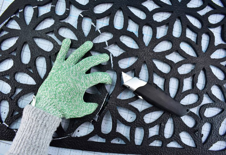 If necessary, gently pry the are you are cutting apart by hand to help your utility knife reach further down into the mat.
