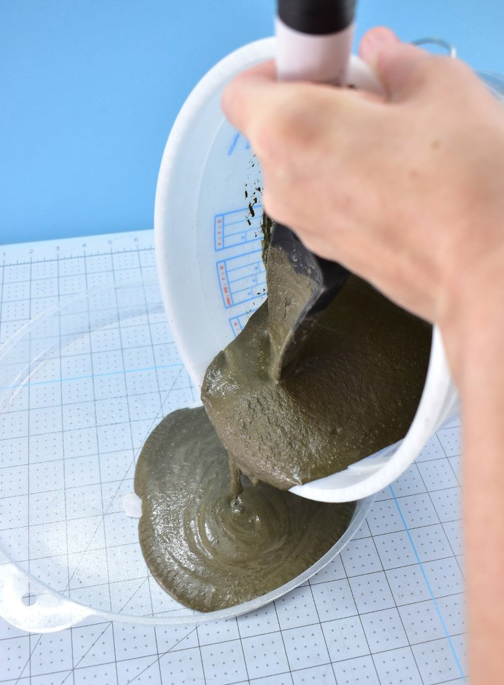 Once you get a thick but pour-able consistency, transfer your mix to the mold. Tap the mold on your work surface several times to break any air bubbles in the mix.
