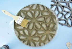 Remove any dust or chunks sanded away by gently brushing off using an inexpensive chip brush.