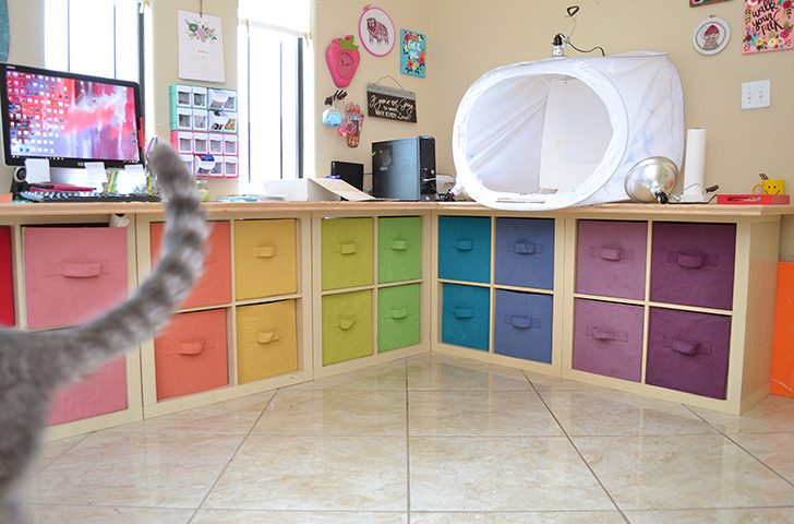 Check out all of this storage in this craft room makeover. And it's so lovely and colorful!