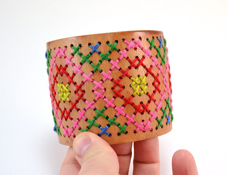 An everyday wood cuff gets an amazing makeover. This DIY stitched wood cuff is a fashion statement you can be proud of!