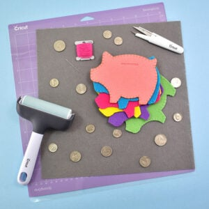 Cut one solid and one slotted pig for each piggy bank. If your cuts are fuzzy, change to a newer or sharper blade for better results.