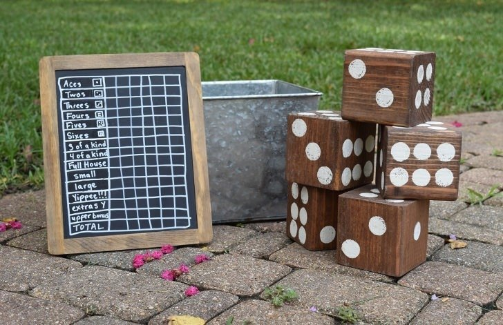 Turn untreated 4x4 lumber into a fun lawn dice game. Use a 5 gallon paint bucket and it's HUGE fun!