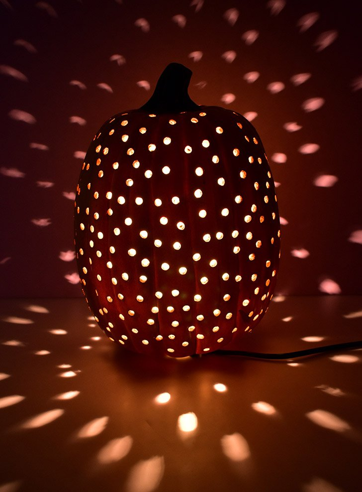 Plug your drilled pumpkin light in and enjoy!