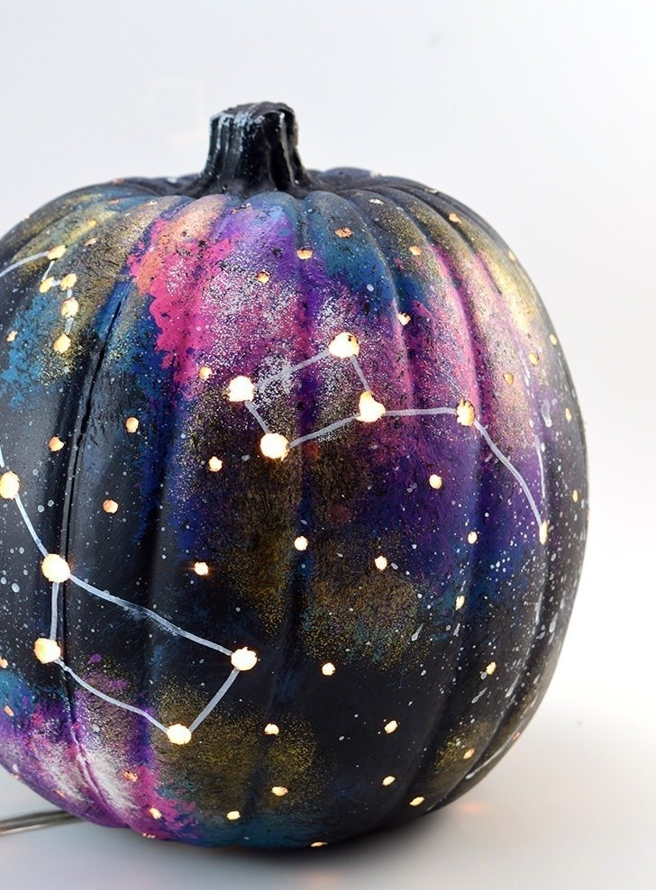 Make a galaxy pumpkin and have one truly out of this world jack-o-lantern!