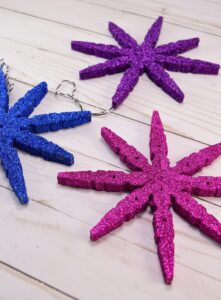 Snowflake ornaments made out of clothespins are genius!