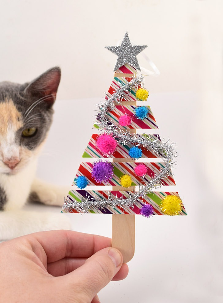Washi tape and popsicle sticks are all you need to make some seriously cute handmade ornaments!