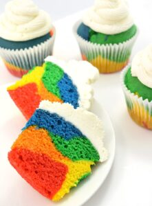 Rainbow cupcakes don't have to take forever... these are quick! And there is a recipe for that grocery store bakery kind of frosting that dries hard!