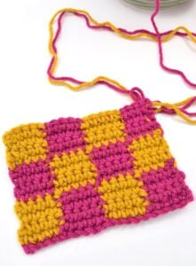 The checkerboard crochet stitch makes a nice, thick fabric and that pattern is amazing. And it's so much easier to do than it looks!