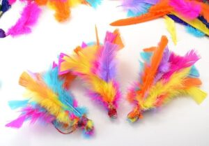 If your kitty loves feathers, and what cat doesn't, she's going to LOVE these DIY feather toys you can make from her. So much sturdier than store bought and cats love homemade!