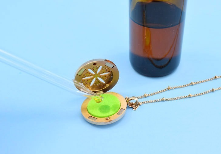 Keep mosquitoes away without a greasy spray. This custom mosquito repellent essential oil blend is easy to make and works perfectly in an essential oil pendant. This pretty mosquito repelling necklace is functional and gorgeous!