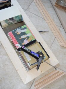 Reclaimed crown moulding from Habitat for Humanity gets added to a cheap mirror for a stunning piece!