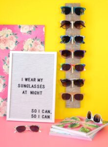 Do you have a million pairs of sunglasses to keep up with? Me, too! This DIY wall hung sunglasses organizer looks great and keeps your sunnies in place!