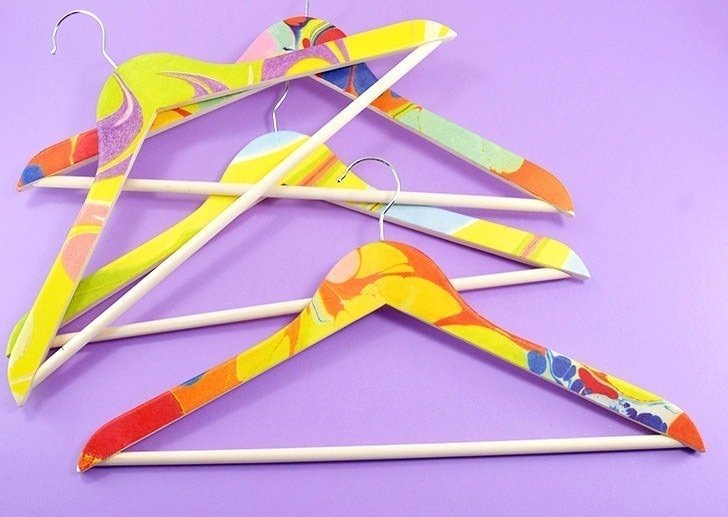 These fancy marbled hangers are actually a super easy decoupage project. Bonus points you don't have to worry about anything coming off on your clothes!