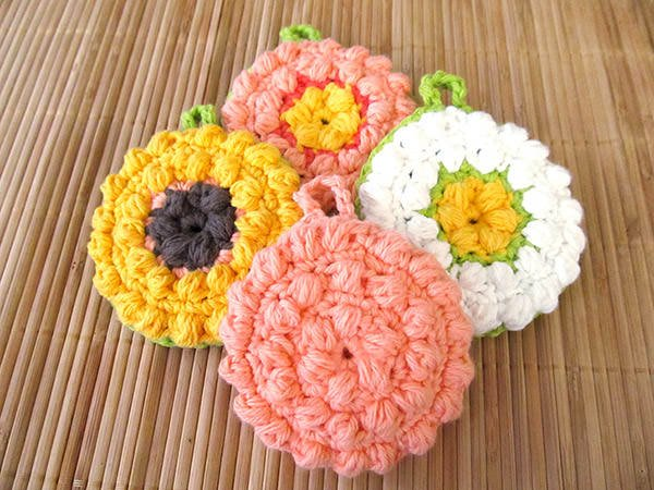 Bust that stash with these fantastic little projects perfect for some stash busting crochet like this awesome set of flower scrubbies!