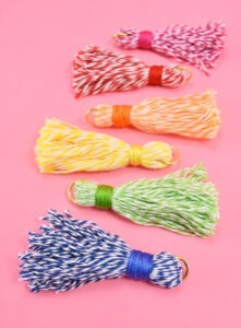These 5 minute baker's twine tassels are so adorable and cost about 33 cents apiece - seriously why buy when DIY is so cheap?!?