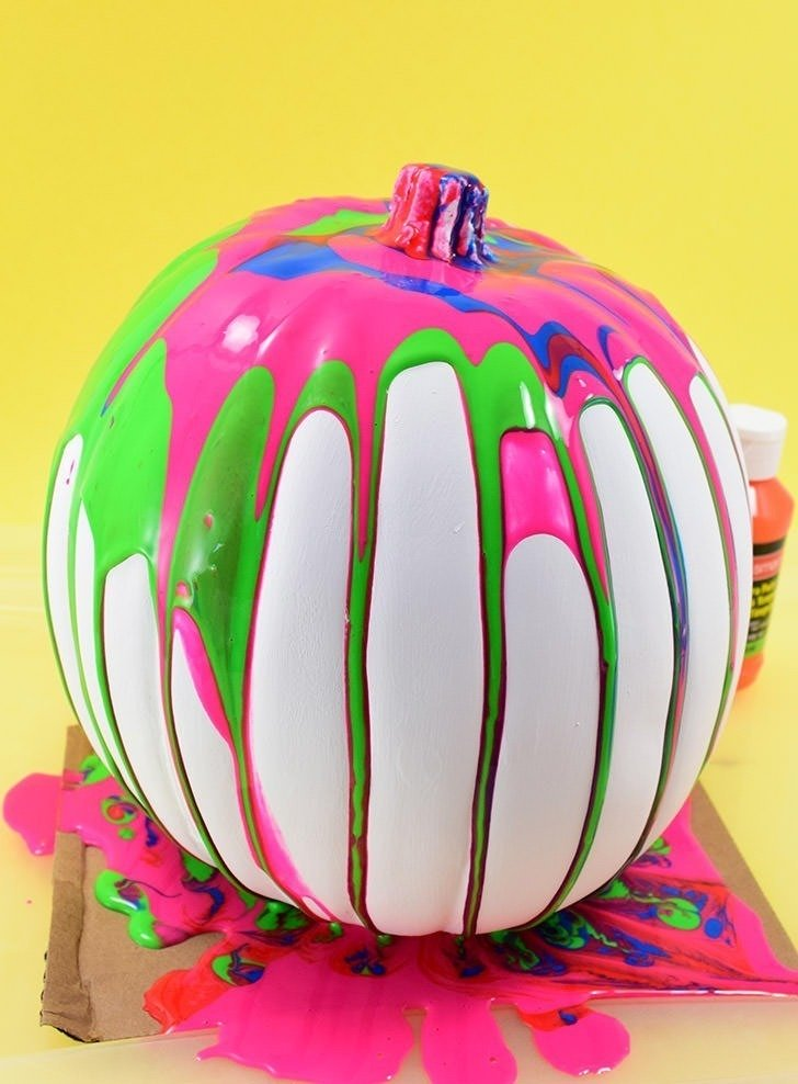 These colorful, drippy no carve pour art pumpkins are super easy and use washable paint making it the perfect Halloween kid craft! Click through for a few tips and tricks so you can achieve pretty results!
