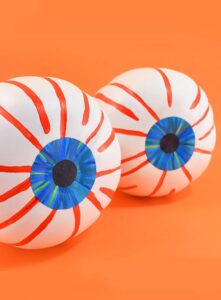 These no carve eyeball pumpkins look so cute in the bushes and you can make them in only 15-30 minutes. Great Halloween craft for the kiddos!